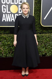 Elisabeth Moss looked adorable in a Dior Couture fit-and-flare LBD with a bedazzled collar at the 2018 Golden Globes.