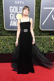 Dakota Johnson was the picture of elegance in a black Gucci velvet gown with a flowing train and a bejeweled belt at the 2018 Golden Globes.