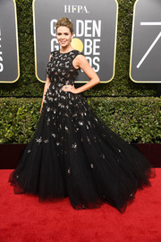 Carly Steel channeled her inner princess in a black Christian Siriano ball gown dotted with silver sequin clusters at the 2018 Golden Globes.