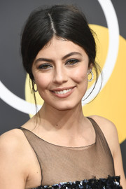 Alessandra Mastronardi went for a loose center-parted updo when she attended the 2018 Golden Globes.