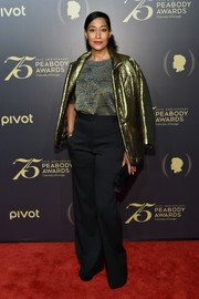 Tracee Ellis Ross teamed her jacket with black high-waisted pants and a knit top.