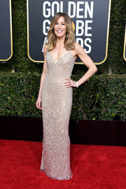 Felicity Huffman glittered in a beaded slip gown by Laura Basci at the 2019 Golden Globes.