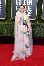 Lucy Liu looked playfully glam in a Galia Lahav Couture sequined one-shoulder gown with a matching sheer cape at the 2019 Golden Globes.