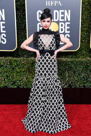 Sofia Carson looked darling in a black-and-white floral-embroidered gown by Giambattista Valli Couture at the 2019 Golden Globes.