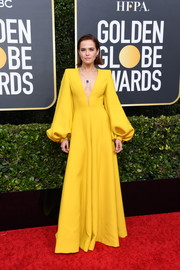 Zoey Deutch looked dowright regal in a deep-V canary-yellow jumpsuit by Fendi at the 2020 Golden Globes.