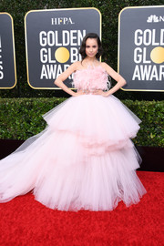 Sofia Carson looked dreamy at the 2020 Golden Globe Awards in a strapless pink Giambatista Valli Couture gown with a feathered bodice and a voluminous tulle skirt.