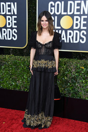 Rachel Bilson looked vampy at the 2020 Golden Globes in a black Brock Collection corset gown with a sheer lace bodice, a peplum waist, and gold embroidery.