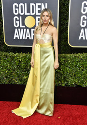 Sienna Miller was summer-glam in a citrus-hued halter cutout gown by Gucci at the 2020 Golden Globes.