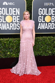 Kirsten Dunst looked sweet and demure in a ruffled pink lace gown by Rodarte at the 2020 Golden Globes.