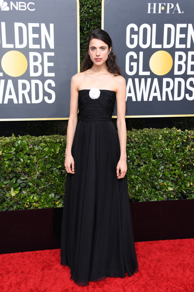 Margaret Qualley went for understated elegance in a strapless black gown with a contrast flower detail at the 2020 Golden Globes.