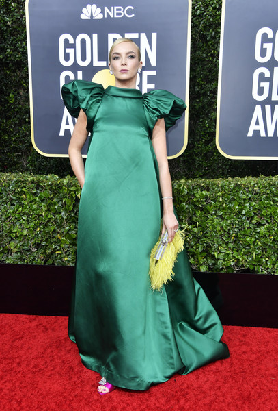 Jodie Comer contrasted her green dress with a yellow feathered clutch by Jimmy Choo.