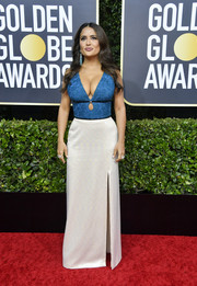 Salma Hayek looked va-va-voom in a low-cut blue and white gown by Gucci at the 2020 Golden Globes.