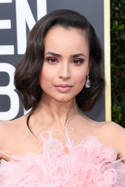 Sofia Carson attended the 2020 Golden Globes wearing her hair pinned up in a faux bob.