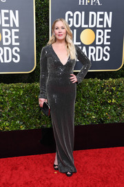 Christina Applegate paired her dress with a black velvet clutch.