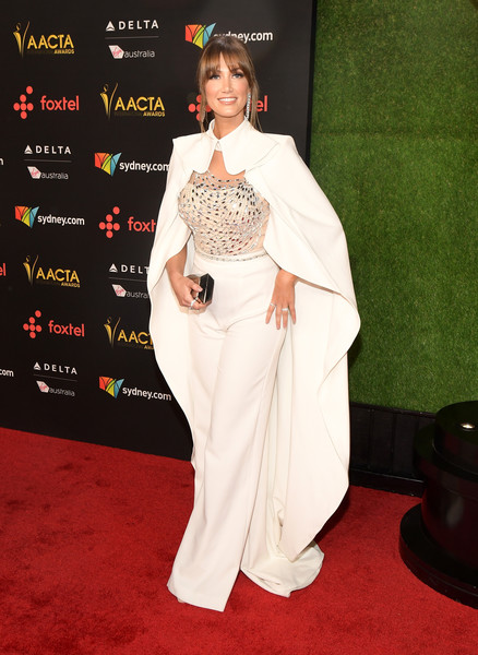 Delta Goodrem turned heads in her Liberace-inspired Mikael D caped jumpsuit at the AACTA International Awards.