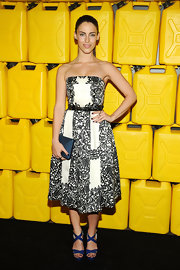 """Jessica Lowndes accessorized her outfit with Lauren Merkin's """"Zoe"""" pyramid hard case clutch in metallic blue."""