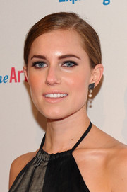 Allison Williams styled her locks in a sleek side-parted chignon for the Exploring the Arts Gala.