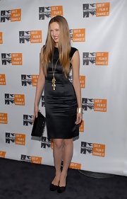 Petra Nemcova kept her look simple, teaming a black sheath with a matching clutch.