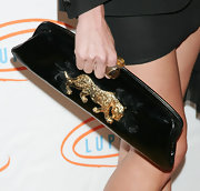 Natalie Coughlin carried a gorgeous patent leather clutch with a gold leopard detail at the 7th Annual Lupus luncheon.