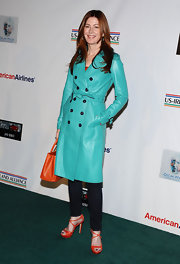 Dana Delany embraced brights in a turquoise leather trench and complementary orange accessories.