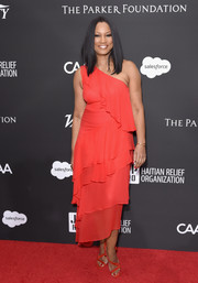 Garcelle Beauvais went for easy sophistication in a tiered red one-shoulder dress at the Haiti Rising Gala.