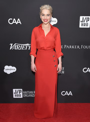Emilia Clarke looked sharp and chic in red silk button-down by Elie Saab at the Haiti Rising Gala.