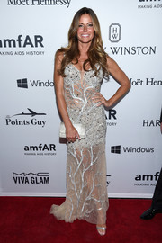 Kelly Bensimon complemented her gown with a white crocodile clutch.