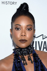 Gabrielle Union pulled her hair back into a tight top knot for the amfAR Inspiration Gala.
