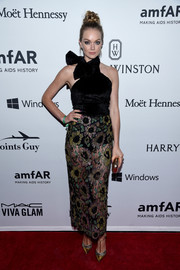 Lindsay Ellingson flashed plenty of skin in a halter dress with a sheer lace skirt during the amfAR Inspiration Gala.