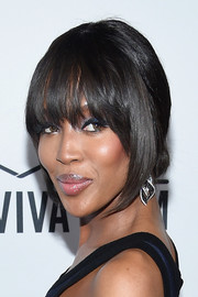 Naomi Campbell wore a conservative chignon (and her signature bangs, of course) at the amfAR Inspiration Gala.