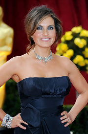 TV actress Mariska Hargitay looked decadent in a navy blue strapless gown which she highlighted with royal jewels and a loose up-do.