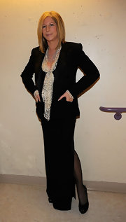 Barbra Streisand chose a black skirt suit and a nude lace blouse for the Academy Awards.
