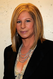 Barbra Streisand's layered diamond necklace added a glam touch to her ensemble at the Academy Awards.