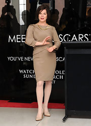 Marcia Gay Harden matched her dress with nude patent pumps at the 'Meet the Oscars' event.