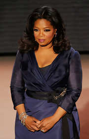 Oprah Winfrey showed off her bouncy curls while attending the Annual Academy Awards.