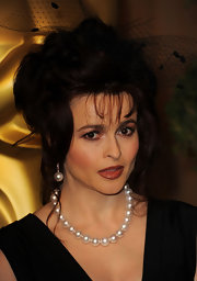 Helena added a classic touch to her look with an elegant pearl necklace.