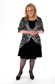 Jacki opted to wear a classic black dress with a sheer zebra print blouse to the Academy Awards luncheon.