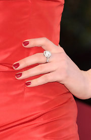 When you're wearing a diamond Tiffany cocktail ring like this one, a perfect manicure is a must. At the 2011 Oscars, Anne matched her Valentino red gown with a classic crimson manicure.
