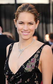 Cody Horn attended the 83rd Annual Academy Awards wearing a sparkling diamond chandelier earrings.