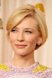 Cate Blanchett highlighted her beaded gown with matching yellow diamond studs.