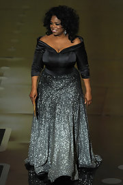 Oprah Winfrey was all about glamour at the Academy Awards in an off-the-shoulder gown with a black bodice and a glittery ombre skirt.