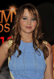 Jennifer Lawrence attended the 84th Academy Awards nominations announcements wearing her long hair in spiral curls with wispy side-swept bangs.
