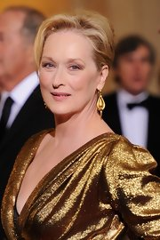 Meryl Streep wore a pair of antique gold pendant earrings at the 84th Annual Academy Awards.