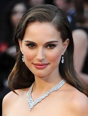 Natalie Portman wore her hair long and with a sleek side part at the 84th Annual Academy Awards.