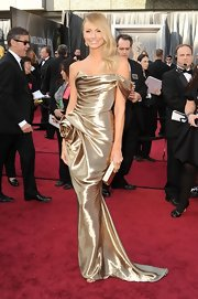 Stacy Keibler showed off her svelte figure in a gold draped gown straight off of Marchesa's Fall 2012 collection.