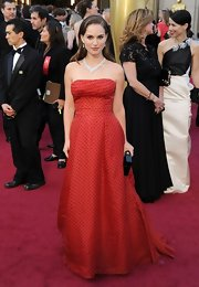 Natalie Portman was picture perfect in a red polka-dot gown paired with opulent jewels.