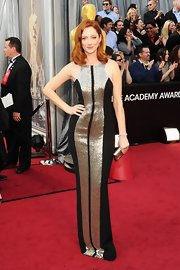 Judy Greer showed off her figure in a fitted black gown with metallic detailing.