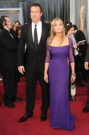 Bo Derek looked ageless and gorgeous at the Academy Awards in a purple evening dress with sheer sleeves.