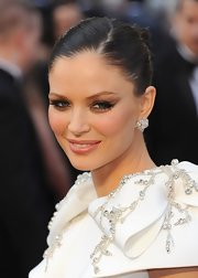Georgina Chapman attended the 84th Annual Academy Awards wearing a pair of pear and marquise-cut diamond cluster earrings.