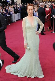 Berenice Bejo sparkled in a mint green beaded gown complete with elegant sheer sleeves.